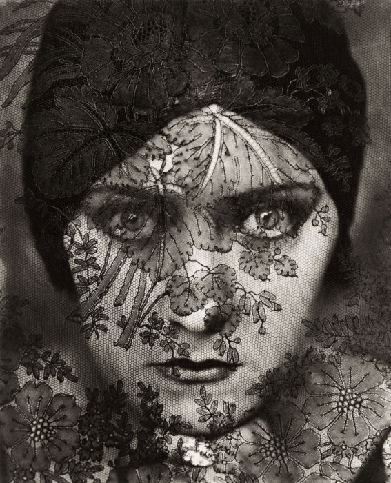"February 1928. Gloria Swanson, behind a curtain of lace, as the first feature-length ""talkies"" were emerging. By Edward Steichen"